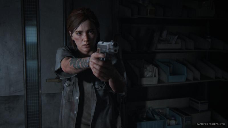 Ellie pointing a gun in The Last of Us Part II